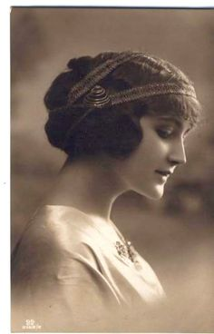 looks like a photo i have of my Italian granny in the 1920s