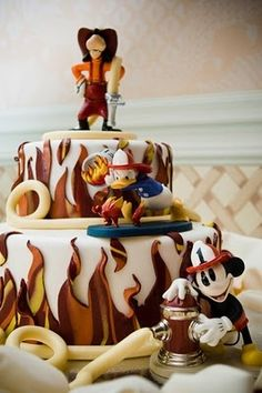 Firefighter cake with Disney characters. Link has other ideas for a firefighter cake, too. This is perfect for Logans 1st birthday! He loves Mickey!