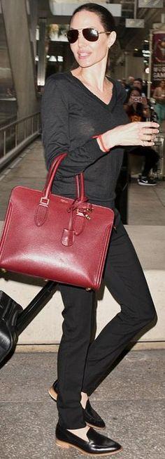 Who made  Angelina Jolie's red handbag?