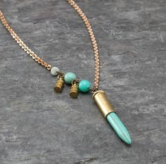 This delicate asymmetrical necklace is made with a long turquoise howlite stick…