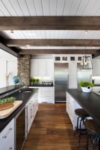 """""""Separation Without Walls"""" article from trendsideas.com: Another view of white painted cabinetry Kitchen. Integration of beamed ceiling with beadboard paneling, wall cabinets, exposed brick."""