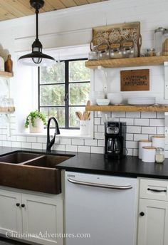 REAL thoughts about this farmhouse kitchen years after renovations - thoughts on the white subway tile backsplash and dark gray grout, copper sink, open shelving, shiplap, and so much more! White Subway Tile Backsplash, Subway Tile Kitchen, White Kitchen Cabinets, Kitchen Backsplash, Black Cabinets, Backsplash Ideas, Sunway Tile Backsplash, Black And White Backsplash, Black Sink