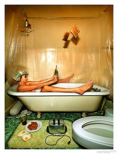 PStarr -  Buzzed on Vodka In a Discoish Helmet Pretend Drunk Driving a Clawfoot Tub With a Frying Pan Steering Wheel While 2 Eggs Collect Germs and Extra Toast Flies Out of an Unplugged Toaster Into The Breakfasty Steam by merkley???, via Flickr