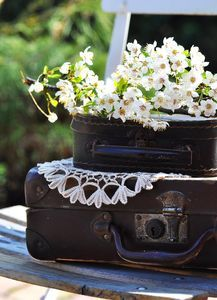 Antique suitcase with flowers