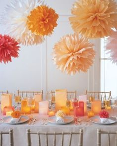 Floral Pom-Poms How-To - Dahlia-like bursts of color hang from the ceiling, adding charm to any party. These tissue-paper pom-poms can be made in the size and color of your choice.  *Many commenters suggested using 12 to 16 sheets of tissue paper because 8 sheets didn't make a full flower.