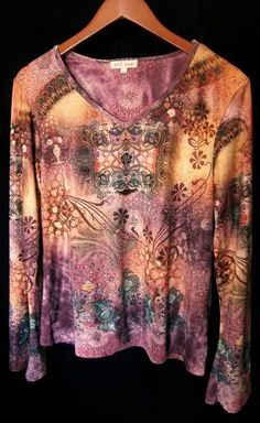 This is a gently worn Xcit USA abstract purple tan brown black casual long sleeve XL Womens Top Blouse. I love the abstract design and colors in this top. There are many beautiful colors - puple brown black white blue green pink orange and gold. Beautiful. This top is a work of art. The eye catching designs will get you many compliments. The material feels soft. The sleeves are belled at the bottom