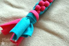 Tie a knot in the end to finish off your DIY fleece dog rope toy! See full tutorial at Making It Home.