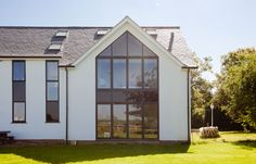 Each bifold doors sits on top of one another separated by a middle layer containing opaque glass