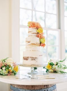 Colorful flower topped naked cake: http://www.stylemepretty.com/2015/10/05/colorful-morais-vineyard-wedding-in-virginia/ | Photography: Joey Kennedy Photography - http://www.joeykennedyphotography.com/