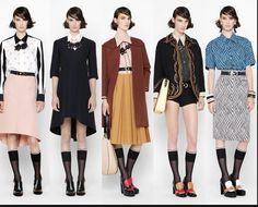 Consuelo Castiglioni styled these garments around 1970s school wear. The girls have high waisted, belted skirts that go below the knee, which simple collared blouses.