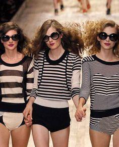 Three models on the catwalk