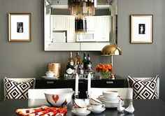 Grey-black-white dining room. Love the textured pillows and grey paint scheme.