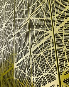 The Rinkeby School and Academy near Stockholm - Lime green network of perforated cladding panels
