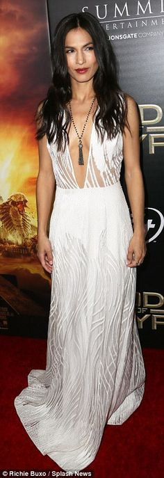 Theme going on: The film's Elodie Yung was every bit the vixen in her plunging white gown ...