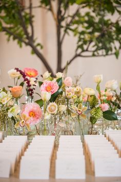 Love this eclectic flower look - small bud vases of flowers on mantles or behind escort cards