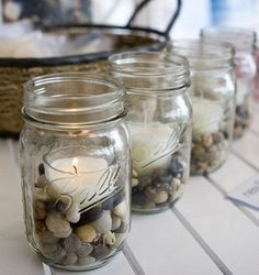 Pebble Stones in Ball Jar with Candles.   Cute, simple, kind of rustic idea for decorating