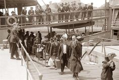 Emigrants at Ellis Island: Picture of Emigrants arriving at Ellis Island in the early 1900's. Ellis Island was first opened on December 31, 1891.