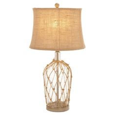 Showcasing a tapered shade and glass base with a netted overlay, this lovely ceramic table lamp casts a warm glow over your master suite nightstand or living...