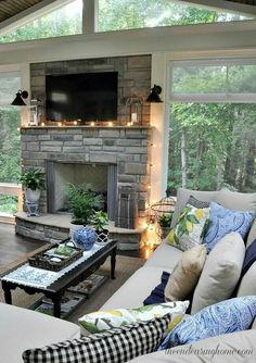 Beautiful room. I love how the window surround the fireplace and make it seem like you're in the woods having a campfire. #home