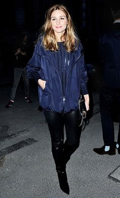 Olivia Palermo wears a striped top, windbreaker, leather leggings, and ankle boots