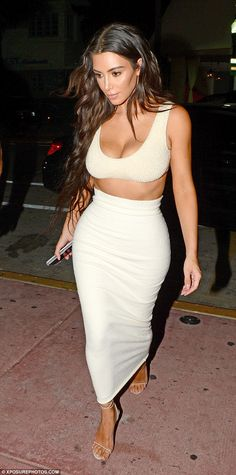 Miami heat! Kim Kardashian kept up with her braless trend on Monday night