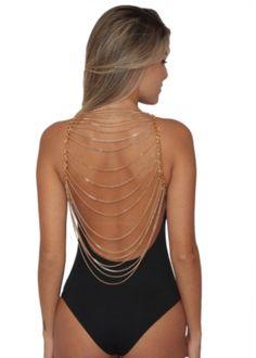 Body BeSweet Preto com Correntes na cor dourada que valoriza as costas. Possui bojo e abertura no gancho. Confeccionada em Lycra 90% Poliamida e 10% Elastano . Ideal para arrasar em todas as ocasiões.