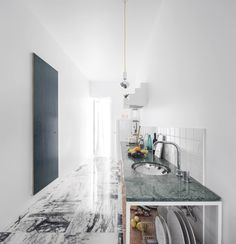 In Lisbon, a Narrow but Glamorous Marble-Clad Apartment