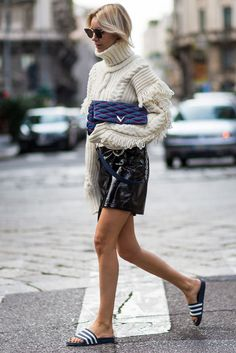 Patent Leather, adidas sliders and a chunky knit #refinery29 http://www.refinery29.uk/patent-vinyl-gloss-trend-aw16#slide-12 Don't worry, patent leather and glossy pieces are as easy to find on the high street as from luxury brands. Lisa Hahnbück wears an OffWhite knit with a Mango asymmetric patent leather skirt, finished off with a Louis Vuitton denim bag and Fendi sunglasses....