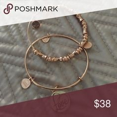 Alex and Ani Bangle Bracelets Two shiny rose gold bracelets from the 2016 Valentines Collection.  Includes the Love Infusion Charm Bangle and a metal beaded bangle. Sorry I do not keep boxes. Alex & Ani Jewelry Bracelets