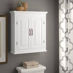Laurel Foundry Modern Farmhouse Banbury W x H x D Solid Wood Wall Mounted Bathroom Cabinet Bathroom Cabinets Over Toilet, Over The Toilet Cabinet, Wall Mounted Bathroom Cabinets, Above The Toilet Storage, Bathroom Wall Storage, Bathroom With Wainscotting, Bathroom Wall Colors, Toilet Room, Bathroom Organization