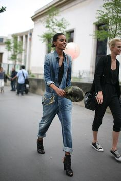 Grace Mahary, rocking a denim jumpsuit.  Paris Couture Week street style [Photo by Kuba Dabrowski]