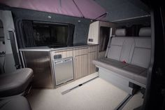 At Detailed Designs we convert T4's T5's and T6's to a very high standard as can be seen in the photos and by looking at our demo vans. Firstly we have a few images of our CNC cut lightweight ply units, using only the best materials and two tambour doors for excellent access both when the bed is down or when it is up as a seat. | eBay!
