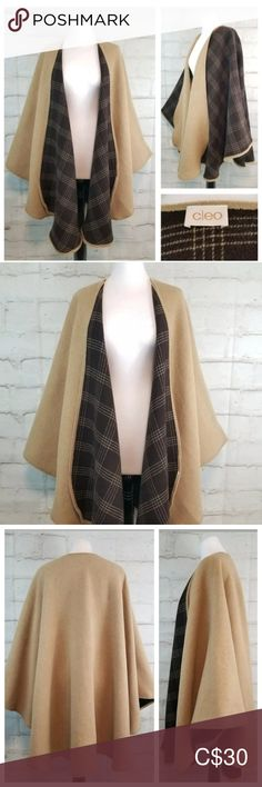 Cleo O/S Beige Brown Plaid Wool Open Shawl Poncho Cleo Open-Front Shawl/Poncho/Cape One Size Fits Most  - fits on the larger side. Beige on outer side. Brown and beige plaid on reverse.  Can be worn either way. Heavy weight fabric. Fabric tag removed  - feels like a wool or a wool blend. Shoulders - 17 to 30+ inches across.  Length shoulders to hem - 36 inches.  Excellent condition  - Pre-owned. cleo Sweaters Shrugs & Ponchos Fabric Tags, Plus Fashion, Fashion Tips, Fashion Trends, Shrug Sweater, Wool Blend, Larger, Shawl, Cape