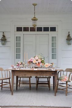 So pretty. Back porch rustic elegance dining space, white exterior space.