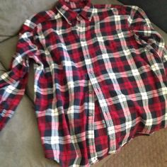 Red Flannel Red oversized flannel. Soft and comfy. Men's size large, but since it is oversized will fit most women for a grunge/Brandy Melville style. Tops