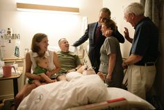 ....President Bush, at the bedside of a Soldier and his family.