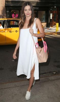 We're sensing a white hot summer trend going on, with Miranda Kerr stepping out in all white while out in New York City on June 8, 2015. The supermodel looked easy breezy in this sundress and matching shoes.