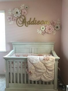 Set of 10 Paper Wall Flowers in Blush and Off White with 6 off white leaf stems. This set makes a great Baby Shower Gift. Add the metal childs name sign or choose flowers only. Metal Sign is 12 tall and up to 24 wide (depending on the number of letters in the childs name) If the child