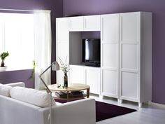The panelled doors of the BESTÅ VASSBO combination, provide hidden, dust-free storage. Adjustable feet give for stability on uneven floors.