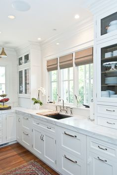 Love the mission style cabinet look,  simple.  Also the brushed nickel hardware