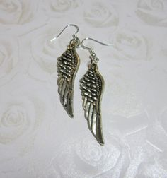Items similar to Feather earrings - with black stained metal on Etsy Wing Earrings, Feather Earrings, Drop Earrings, Heart Jewelry, Metal Jewelry, Handmade Jewelry, Unique Jewelry, Handmade Gifts, Black Stains