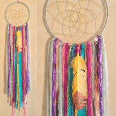 this lovely dreamcatcher is created from a variety of lace and trims and adorned with a gold hued glittered feather. measuring approximately 9 x42 it is