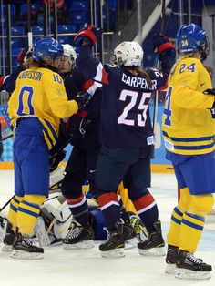 USA forward Alex Carpenter (25) celebrates with teammates after scoring a goal against Sweden in Monday's semifinal.