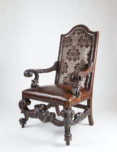 This handcrafted leather seat chair exudes old world luxury and charm.