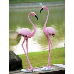 Features:  -Constructed from aluminum.  -Pink finish.  Product Type: -Statue.  Color: -Pink.  Style: -Contemporary.  Material: -Metal.  Theme: -Animal. Dimensions:  Overall Height - Top to Bottom: -42