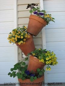 This is a GREAT idea! I have been searching for a outdoor plant stand and just havent spent the money!