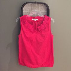 Red sleeveless LOFT top Hello Miss 4th of July! Super cute sleeveless red top from LOFT. Has a ruffled detail around the collar bone area. Top has a very small bit of elastic at the bottom. Looks awesome with white skinnies, denim skinnies or you could dress it up under a straight skirt and blazer to wear to work. Size small. 4th of July red. Loose fitting. LOFT Tops Tank Tops