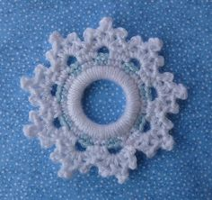 Ravelry: Peppermint Snowflake Ring Ornament by Doni Speigle.This should be easier to crochet than some snowflakes!Peppermint Snowflake Ring ornament is the (and final) of my 2012 Ring Ornament Series. The ornament was made using Caron& Simply Soft. Crochet Snowflake Pattern, Crochet Snowflakes, Crochet Stitches Patterns, Thread Crochet, Crochet Motif, Crochet Crafts, Crochet Yarn, Crochet Flowers, Crochet Projects