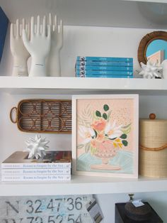 shelf styling, with art by Lulie Wallace
