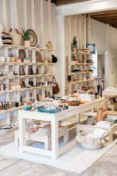 This store has a various amount of products. Between the table and the wall and the benches/baskets infront of the table- all product is displayed for the customer to easily shop. It is all very eye appealing and calming towards the store.
